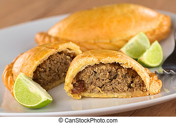 Peruvian snack called Empanada pie filled with beef and...
