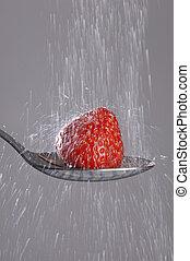 Cascade of sugar on a strawberry