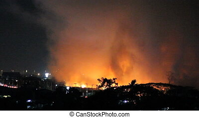 Wild Fires At Night Burn - Wild fires burn out of control in...