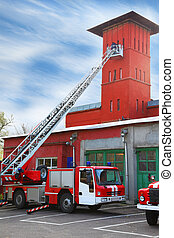 fire station, red fire truck with long ladder, red high...
