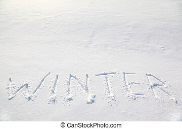 big words quot;winterquot; on the white cold snow field,...