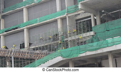 Construction Workers At Mall - An exterior shot of workers...