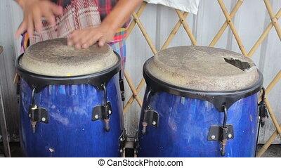 Asian Street Musician Plays Congas - An Asian street...