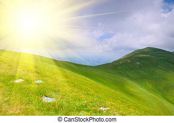 Mountains hills and sunbeams - Beautiful blue sky and green...