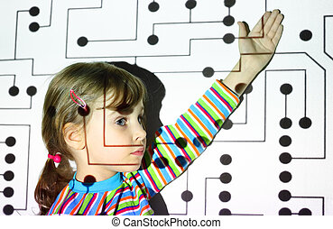 little girl in striped shirts shows on black circle on circuit, board, projector