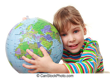 beautiful little girl in striped shirt play with inflatable globe