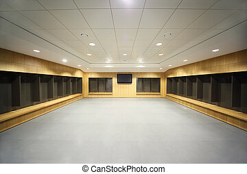 large clean locker room. gray floor and ceiling, big...