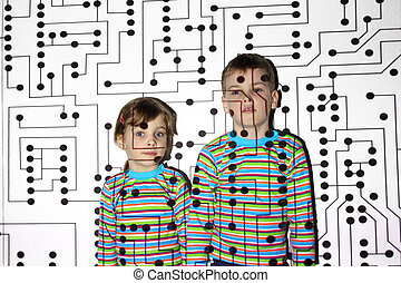 little brother and sister in striped shirts, circuit, board, projector