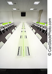 large bright dining room with white tables and chairs,...