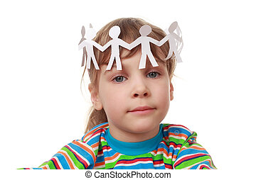 beautiful little girl in striped shirt and chaplet from garaland of paper creatures