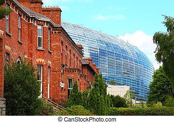 Stadium Aviva and red brick building at day in Dublin,...