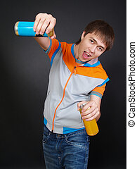 young man in fashionable clothes with drinks - The young...