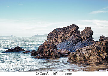 Rocky Shore - sea with brown rocks at sunny day