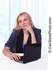 Pretty happy Caucasian business woman at office desk daydreaming thinking