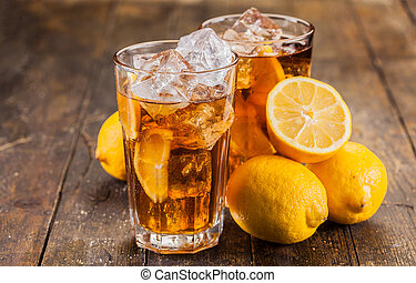 Lemon Ice Tea on wooden table - lemon ice tea on brown...