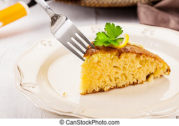 Lemon Sponge Cake on white wooden table