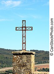 Cross - Metal cross standing on a top of hill in France