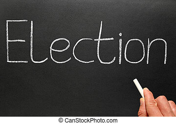 Election, written with white chalk on a blackboard.