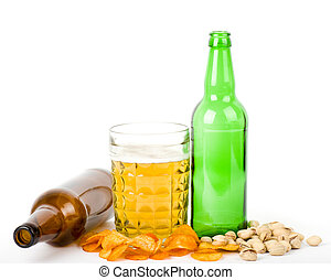 Beer green bottle and potato chips, pistachios isolated on a...