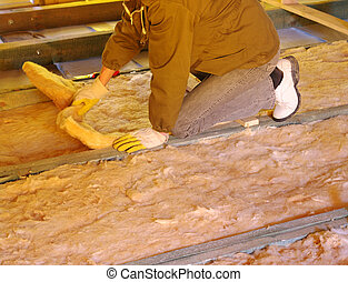 glass wool - Construction worker thermally insulating house...