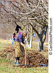 Mother and daughter working in an orchard