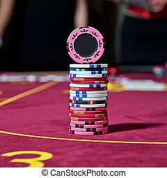 casino chips - tower from chips on the poker table