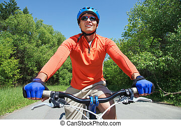Male on bicycle