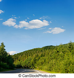 road in mountain under cloudy sky