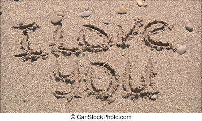 "inscription""I love you ""in the sand"