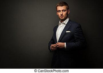 handsome businessman on black