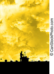 chimney sweep silhouette on the rooftop - silhouette of a...