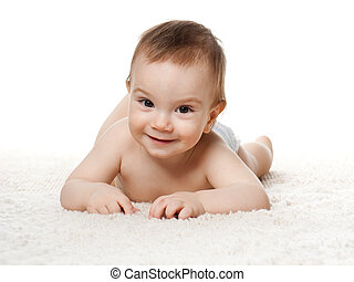 Baby boy on the carpet - A baby boy is lying on the carpet;...