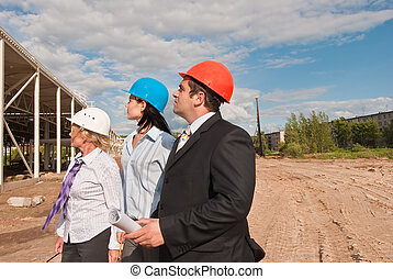 Director with subordinates on construction site of shopping cent