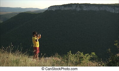 Boy shoot  in the mountains