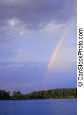 Rainbow landscape - Beautiful Minnesota lake with rainbow in...