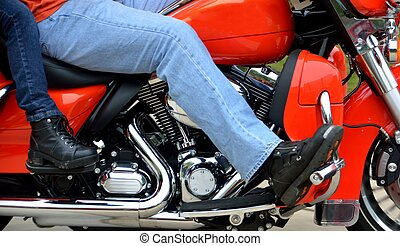 Motorcycle Riders - Motorcycle bikers driving by showing a...