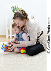 Mother and daughter playing in the children's cubes