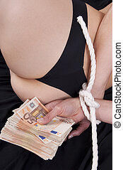 Woman with arms bound holds banknotes - prostitute with arms...
