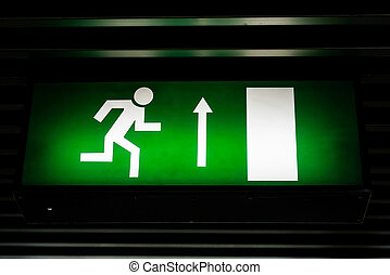 Exit sign in dark colors