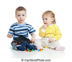 Children playing with  mosaic toy. Concept for health hazard to