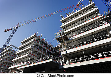 building construction - big construction site with crane and...