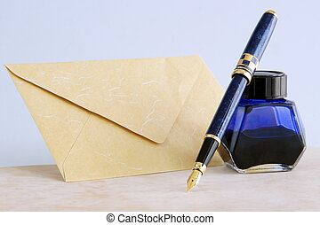 Fountain pen and ink - A fountain pen with blue ink and...