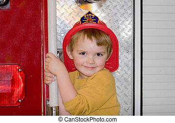 I Wanna Be A Fireman - Young boy visiting the firestation...
