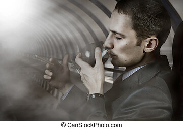 Portrait of man with glass and cigar - Luxury life. Portrait...