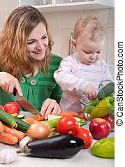 Vegetable salad preparation - Young mother preparing fresh...