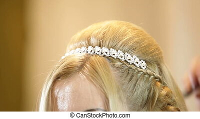 Wedding Hairstyle - Hairdresser pinning up bride's hairstyle...