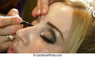 Young Woman Having Eye Makeup