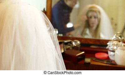 Bridal Hairstyle - Bridal hairdresser making hairstyle in...
