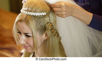 Putting On The Veil - Hairdresser putting on bridal veil