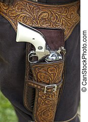 Revolver - Six-shooter in gun belt strapped to cowboy